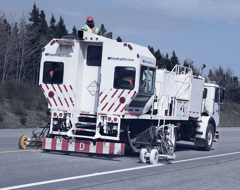 photo of a road striping truck